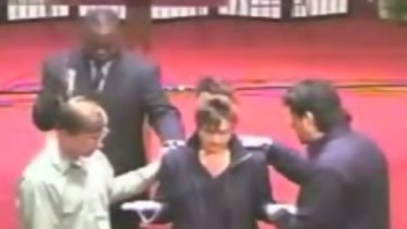 YouTube clip of Thomas Muthee (rear) blessing Sarah Palin.