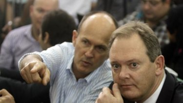 The Australian ambassador to Egypt, Dr Ralph King, right, sits next to Andrew Greste, brother of defendant Peter Greste during the sentencing hearing.