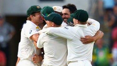 Mitchell Johnson celebrates taking the final wicket.