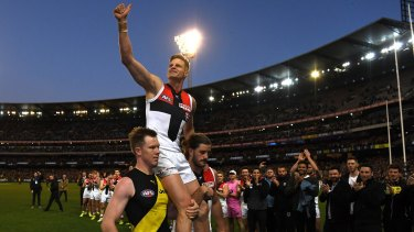 Leading light: St Kilda club champion Nick Riewoldt, carried off by cousin Jack, left, and teammate Josh Bruce.