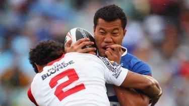 Joseph Paulo of Samoa is tackled.