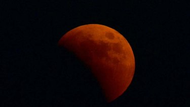 A picture taken in Belgrade overnight shows the moon in a stage of a total lunar eclipse.