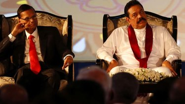 Sri Lankan President Mahinda Rajapaksa, right, and Foreign Minister Gamini Lakshman Peiris. The biannual Commonwealth Heads of Government Meeting will take place from November 15-17,