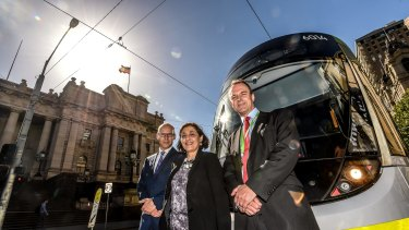 Energy Minister Lily D'Ambrosio with PTV chief executive Jeroen Weimar  (left) and Yarra Trams executive director Rob Robson.