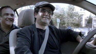 Banned: Director-star Jafar Panahi in <i>Tehran Taxi</i>.