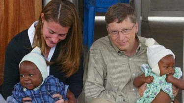 Bill Gates and his wife Melinda hold babies during a visit to the Manhica Health Research Centre in Mozambique