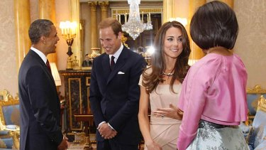 Setting off a fashion frenzy ... the Duchess of Cambridge chats to Michelle Obama, while  US President Barack Obama talks to Prince William.