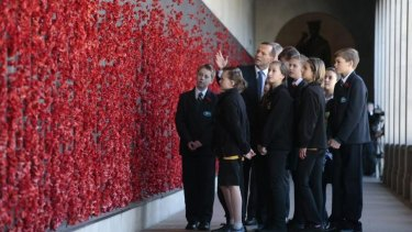 World War One Centenary Wreath Laying Ceremony at the Australian War Memorial. Prime Minister Tony Abbott walks with students from Campbell Primary School and Jerrabomberra Public School along the the Roll of Honour following the wreath laying ceremony. 4 August 2014.