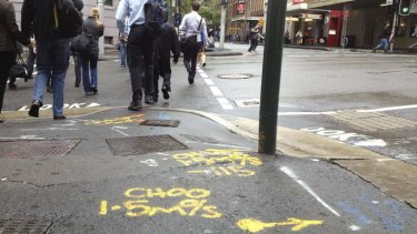Rune the day: Street markings on the corner of Druitt and Kent streets in Sydney.