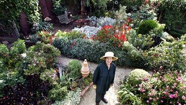 Proud water miser Nancy Brewer in the Ballarat garden that thrives on her ingenuity.