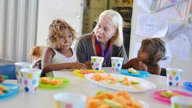 Professor Colette Tayler with early learners at the Wakathuni 0-5 Chrildren's Centre.