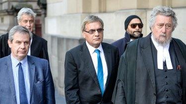 Art dealer Peter Gant and conservator Mohamed Aman Siddique leave the Court of Appeal after their sentences were quashed.
