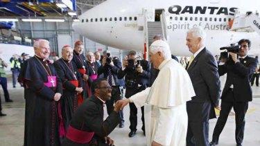 MonsignorJude Okolo farewells Pope Benedict at Sydney Airport.