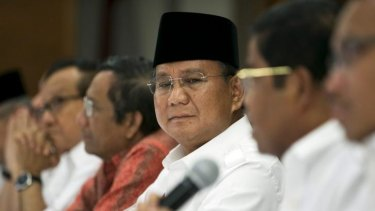 """I question the legitimacy of this process. It might lead to a situation where the process will be regarded as invalid"": Prabowo Subianto, centre."
