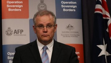 Hard line ... Immigration Minister Scott Morrison can expect questions about whether the Australian navy loaded three asylum seekers from a boat that was turned around in February.
