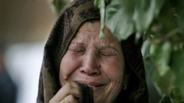 A Palestinian woman mourns the death of loved one following the attacks.