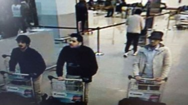"A hunt is under way for a ""man in white"", one of three men filmed pushing luggage trolleys in Zaventem Airport before the blasts in the departure hall. Authorities say the other two men, dressed in black, were suicide bombers."