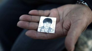 Trapped . . . the mother of one of the miners show a picture of her son Esteban Rojas Carrizo.