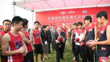 Lord Mayor Robert Doyle, doing his bit for Melbourne, in China for the launch of a $1.5 million AFL football oval in Tianjin.