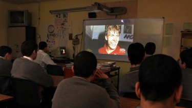 History teacher Eugene Ryan shows Youtube videos of Jim Stynes to a class of boys in Stynes's former school, De La Salle College.