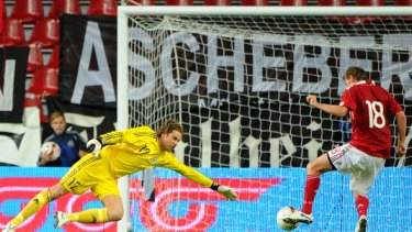 Germany's goalkeeper Tim Wiese fails to save a goal by Denmark's Mads Junker.