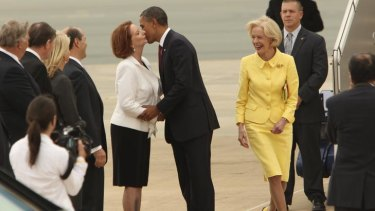 Quentin Bryce and Julia Gillard greet Barack Obama at Canberra Airport.