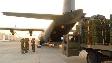 An Australian C-130 transport plane has been dropping food and water to thousands of Yazidi refugees stranded in barren mountainous areas in northern Iraq.