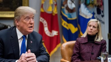 President Donald Trump's (seen here with Secretary of Homeland Security Kirstjen Nielsen) decision to end the protected status for Salvadorans is part of his broader push to tighten immigration laws and expel those living in the US illegally.