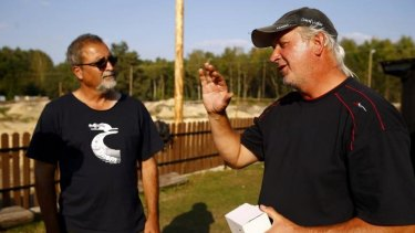 Archaeologists Yoram Haimi and Wojciech Mazurek (right) discuss their discoveries at the  Nazi's Sobibor death camp.