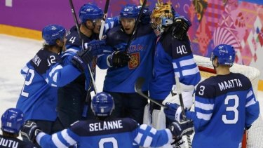 Joyful underdogs ... Finnish players celebrate after defeating Russia 3-1 in the quarter-final.