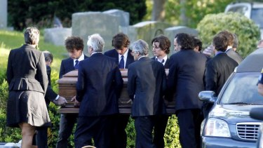 Members of the Kennedy clan, including Mary Kennedy's children, carry her coffin to her burial site.