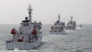 Taiwan Coast Guard patrol ships are seen during a drill about 30 nautical miles north-west of the port of Kaohsiung, southern Taiwan.