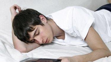 Generic pic of sleep-deprived teen using technology Thinkstock