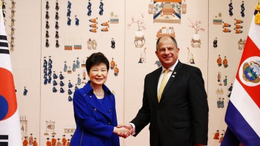 Costa Rican President Luis Guillermo Solis, right, shakes hands with South Korean President Park Geun-hye last year.