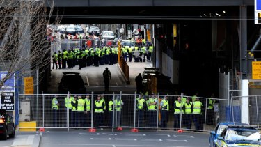 Taking control ... Police at the Grocon building site at Lonsdale Street this morning after using an RDO to wrest back control from blockading workers in a late-night operation.