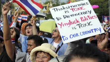 Anti-government protesters hold a banner during a demonstration against an amnesty bill in Bangkok, Thailand.