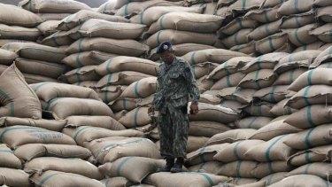 Sacks of rice pile up  at a warehouse in Ayutthaya province, north of Bangkok.
