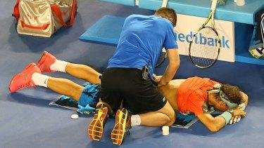 Rafael Nadal gets treated during the men's final against Stanislas Wawrinka.