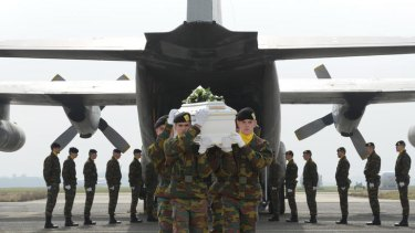 Belgium Defence Force soldiers carry coffins of those killed in Switzerland.