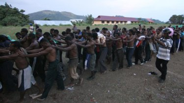 Prisoners are led away from the Third Papuan People's Congress. At least six people were killed and about 300 arrested by Indonesian police and military.