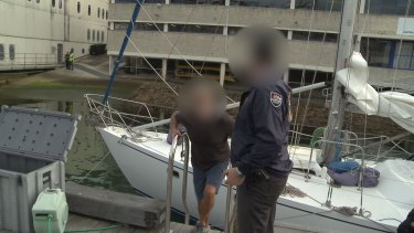 Hamish Thompson is arrested by police after they allegedly seized 1.4 tonnes of cocaine from the yacht Elakha.