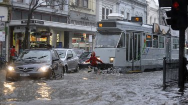 Tram ahoy ... flooding yesterday on the corner of Chapel Street and Commercial Road in Prahran, Melbourne.