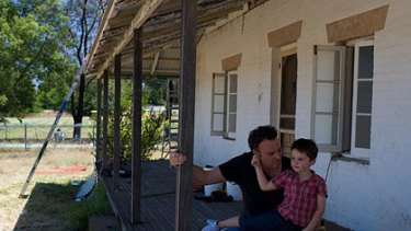 History ... Adrian Nesbitt and his son, Archie, 4, at the former family home built around 1815.