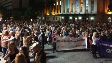 Crowds march from King George Square to Kurilpa Park for a vigil for slain student Sophie Collombet.
