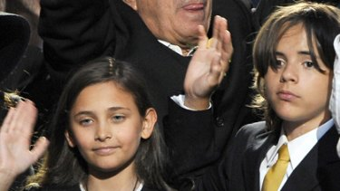 Not coping ... Paris Jackson, left, Prince Michael Jackson II (also known as Blanket), and Prince Michael Jackson I, right, pictured at their father's funeral.