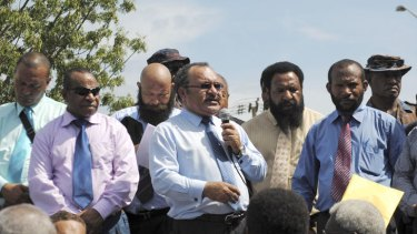 Power struggle ... Prime Minister Peter O'Neill, centre, addresses his supporters in Port Moresby earlier this year.