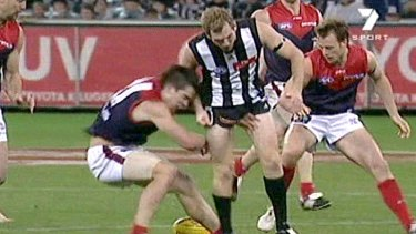 Collingwood's Ben Johnson crashes into Melbourne's Dannie Bell, knocking him unconscious, in 2007.