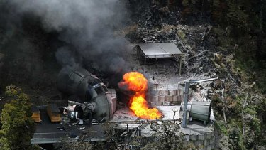 Flames burn above a ventilation shaft at New Zealand's Pike River Mine last November.