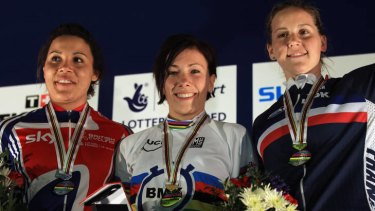 Shanaze Reade (2nd) of Great Britain, Caroline Buchanan (1st) of Australia and Eva Ailloud (3rd) of France stand on the podium after the final of the women's time trial at the BMX world championships.