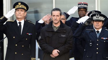 French police officer Philippe Brinsolaro (centre), brother of slain police officer Franck Brinsolaro, observes a minute of silence in Marseille for the victims of the attack.
